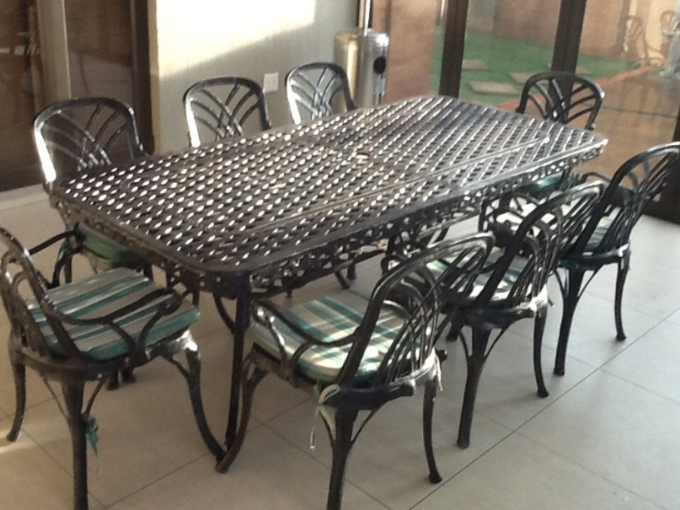 Image of: Wrought Iron Patio Chairs Feet Glides