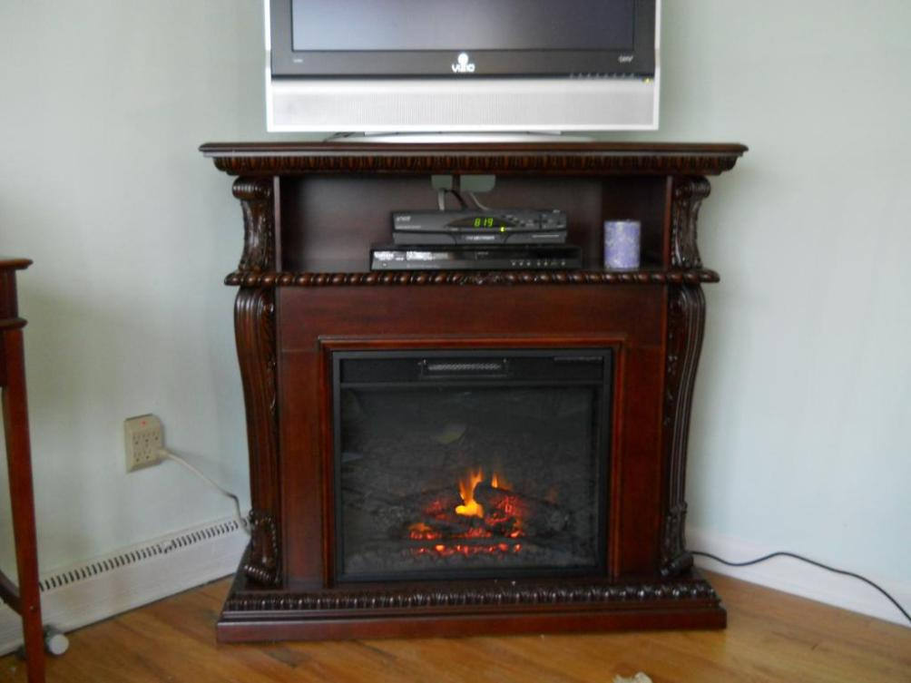 Image of: Corner Tv Stands With Electric Fireplace