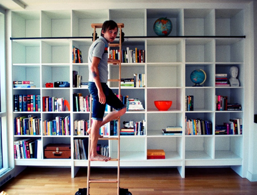Image of: Triple bookcase with ladder and rail