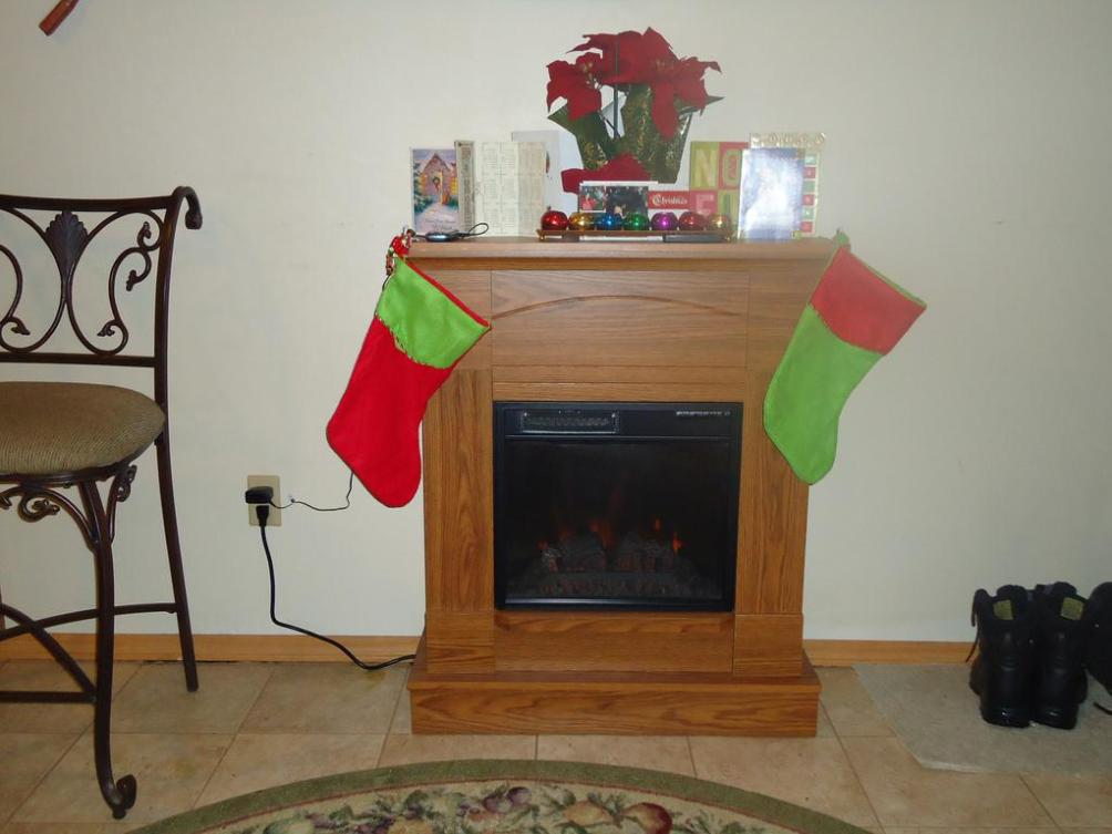 Image of: Free Standing Electric Fireplace With Mantel