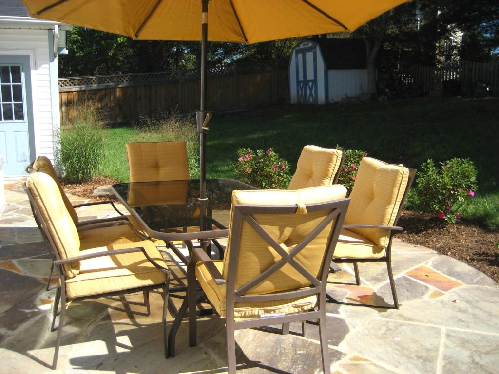 Image of: Patio Dining Set with Umbrella Yellow