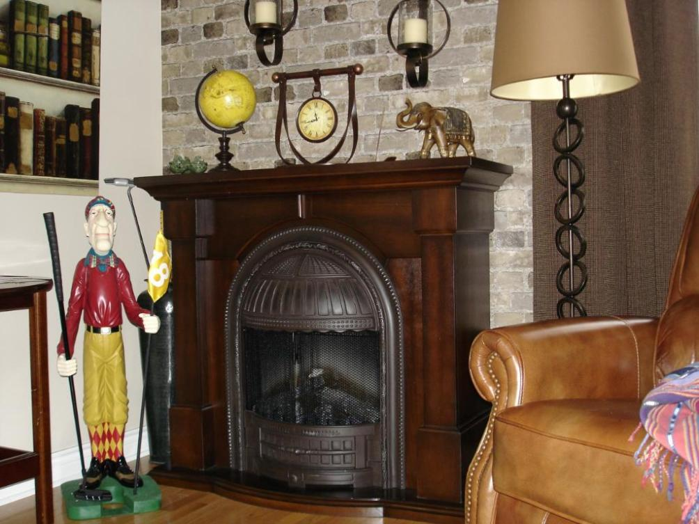 Image of: Unifire Polystone Electric Fireplace With Mantel