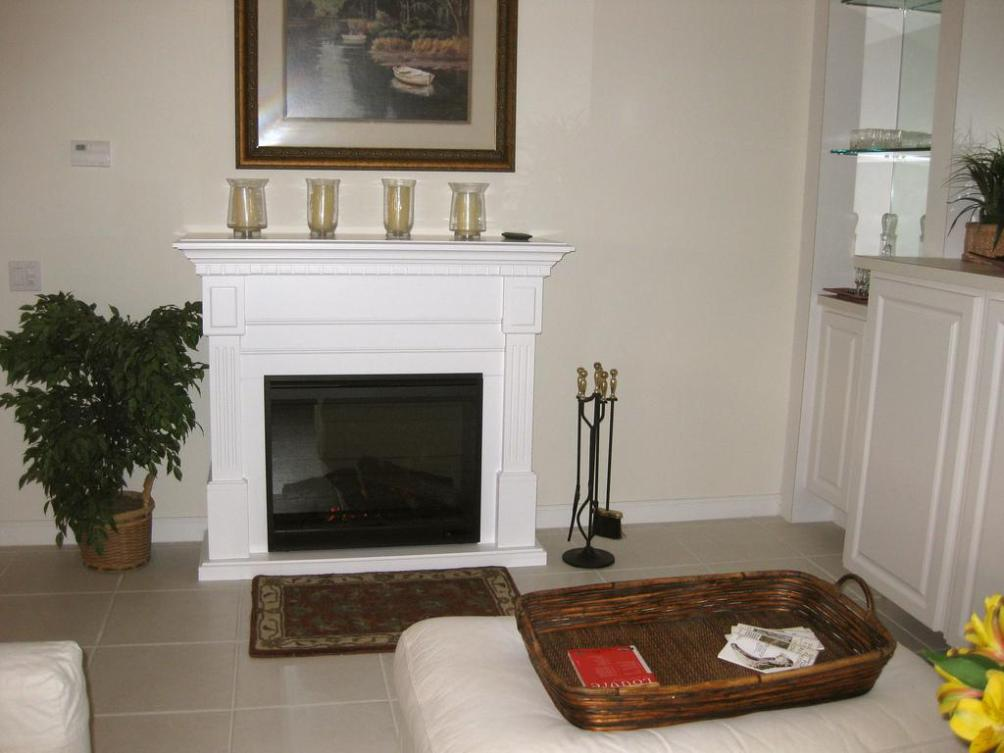 Image of: White Electric Fireplace With Mantel