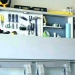 Broom Storage Ideas above Refrigerator